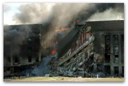 The Pentagon in flames on September 11, 2001, after terrorists flew hijacked American Airlines Flight 77 into the side of the building.