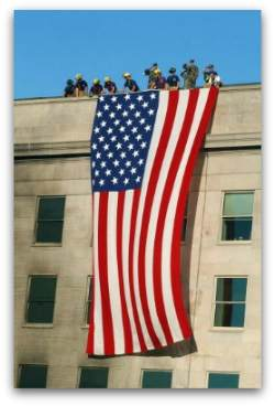 A huge American flag is draped over the side of the damaged Pentagon after the terrorist attacks of September 11, as a symbol, to both Americans and the terrorists, of American pride, strength, and determination.