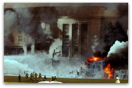 The Pentagon in flames after terrorists flew hijacked American Airlines Flight 77 into the side of the building on September 11, 2001.
