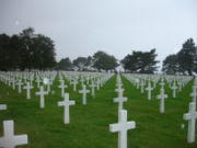 White marble crosses, perfectly aligned, mark the final resting place of more than 9,000 American servicemen who died during or shortly after the D-Day landings at Normandy.