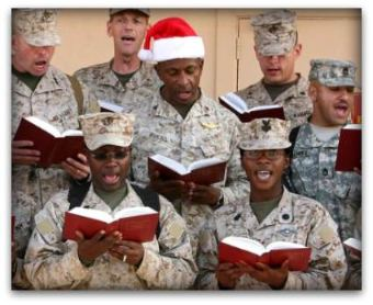 US troops pause to enjoy Christmas carols, even in a war zone.