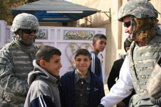 Gold Star Mom Debbie Lee, proud mother of Marc Lee, the first Navy SEAL killed in Iraq, dons body armor to meet Iraqi children in the same streets where her youngest child died.