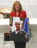 Gold Star Mom Debbie Lee holding a photo of her son Marc, the first Navy SEAL killed in Operation OIF.