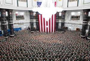 More than 1,200 American troops re-enlist on July 4 in Saddam's al Faw Palace in Baghdad.