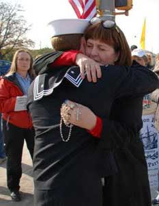 Accused Navy SEAL Matthew McCabe receives a hug of support and a rosary from Donna Zovko, mother of slain Blackwater guard Jerry Zovko.