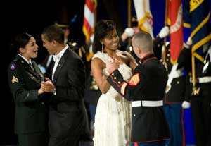 President Obama and the First Lady dance with service members at the Commander-in-Chief Inaugural Ball.