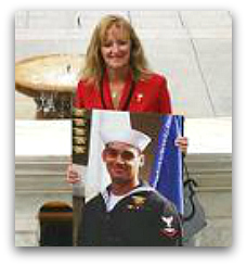 Debbie Lee with photo of her son Marc