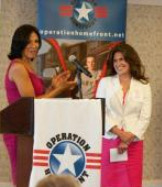 Military Motherhood Award 2010 recipient Robin Schoolfield is presented the award by actress Wendy Davis of <i>Army Wives.</i>