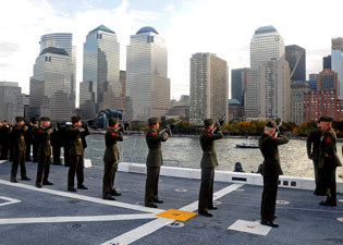 Abeam Ground Zero, USS New York fires a 21-gun-salute in tribute to all who died on September 11, 2001.