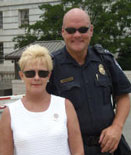Beverly Perlson, founder of Band of Mothers, with Capitol Policeman