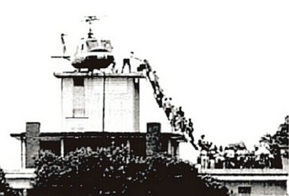In this iconic photo that has come to symbolize the fall of Saigon, Vietnamese citizens line up for evacuation by an Air America helicopter from the roof of the Pittman Apartments building in Saigon.  For nearly 40 years, the location in this photo has been mistakenly identified as the U.S. Embassy.  It is not.