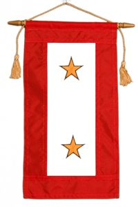 Service flag with two gold stars, representing two family members who died on active duty.