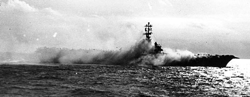 Smoke pours from Hangar Deck #1 onboard USS ORISKANY (CV-34), during the fire which killed 44 of her officers and men.  Official Navy photograph.