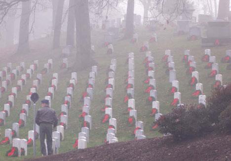 Air Force pilot helps lay Christmas wreaths at Arlington National Cemetery